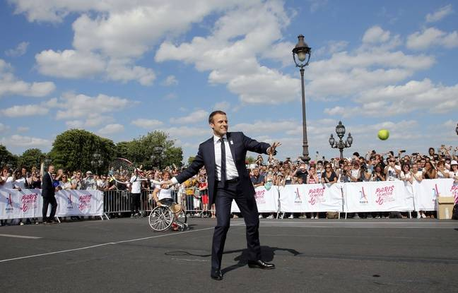 French President Emmanuel Macron plays tennis on the Pont Alexandre III in Paris, France, June 24, 2017. The French capital is transformed into a giant Olympic park to celebrate International Olympic Days with a variety of sporting events for the public across the city during two days as the city bids to host the 2024 Olympic and Paralympic Games.