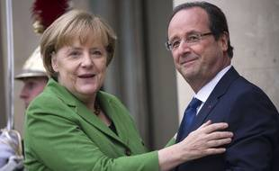 Angela Merkel et François Hollande le 12 novembre 2013 à Paris. AFP PHOTO / FRED DUFOUR