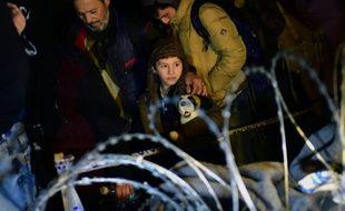 Des migrants à la frontière entre Hongrie et croatie, à Zakany le 16 octobre 2015