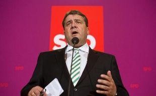 """Les sociaux-démocrates allemands ont décidé vendredi soir d'entamer des discussions avec les conservateurs d'Angela Merkel en vue de former éventuellement un gouvernement de """"grande coalition""""."""