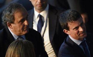 Le président de l'UEFA Michel Platini (gauche) et le Premier ministre Manuel Valls à Berlin le 6 juin 2015