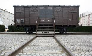 A picture taken on April 11, 2009, outside Paris, shows the wagon of the memorial of the Drancy camp, repainted after it was covered with swastikas. Drancy was the site of the detention centre and railway depot from where most of the 76,000 Jews deported from France left on their last journey to the Nazi death camps. AFP PHOTO LOIC VENANCE