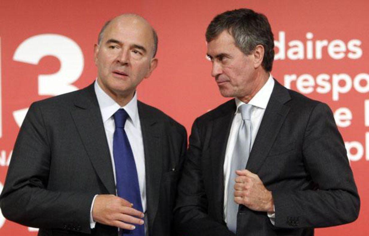Pierre Moscovici et Jérôme Cahuzac lors de la présention du projet de loi de finances 2013 le 28 septembre 2012. –  CHESNOT/SIPA