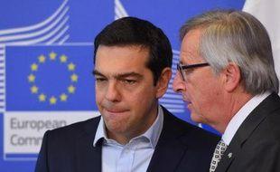 Le Premier ministre grec Alexis Tsipras et le président de la Commission européenne Jean-Claude Juncker le 13 mars 2015 à Bruxelles