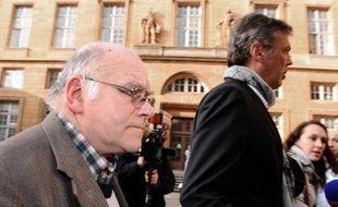 Henri Leclaire, accompagné de son avocat Thomas Hellenbrand, à son arrivée le 1er avril 2014 au tribunal de Metz