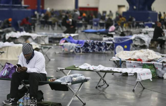 648x415 man looks for information his cell phone he rest at the george r brown convention center february 17 2021 in houston texas winter storm has caused rol