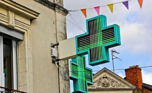 Une croix de pharmacie (Illustration).
