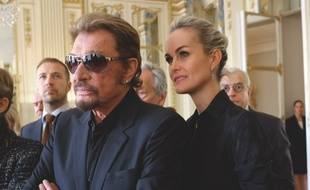 Johnny Hallyday et son épouse Laeticia à Paris le 13 octobre 2015