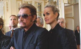 Johnny Hallyday et son épouse Laeticia à Paris le 13 octobre 2015