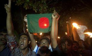 Des habitants de Dashiar Chhara fêtent le 1er août 2015 l'accord qui a permis à cette enclave jusqu'ici indien de faire partie désormais du territoire du Bangladesh
