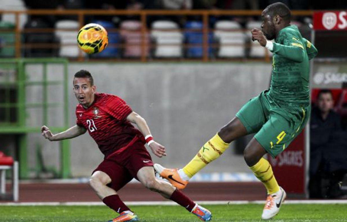 Le défenseur central camerounais Jean-Armel Kana Biyik sous le maillot du Cameroun contre le Portugal. – PEDRO NUNES / AFP