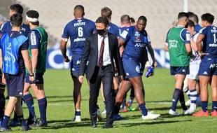 Laurent Marti, le président de l'UBB au milieu de ses joueurs.