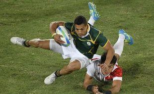 Le Sud-Africain Cheslin Kolbe face au Japon lors du match de rugby à VII pour la médaille de bronze aux Jeux Olympiques de Rio, le 11 août 2016.