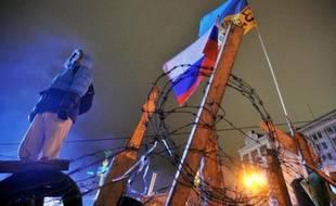 Le président ukrainien Viktor Ianoukovitch a promulgué vendredi de nouvelles lois visant à limiter les manifestations malgré les vives protestations de l'opposition et des pays occidentaux.