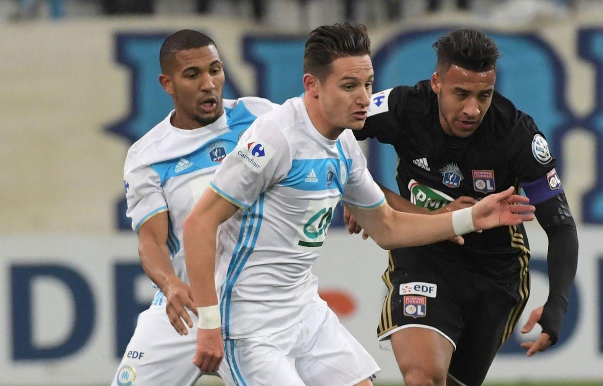 Corentin Tolisso et Florian Thauvin, face à face en Coupe de France – ANNE-CHRISTINE POUJOULAT / AFP