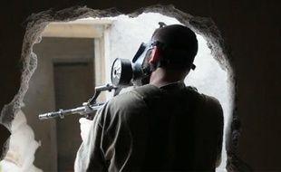 Capture d'écran d'une vidéo du Monde.fr montrant des combattants rebelles en Syrie, au printemps 2013.