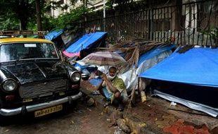 Réputé pour la qualité de ses soins et ses tarifs peu élevés, l'hôpital Tata Memorial de Bombay attire des malades du cancer par milliers. Mais beaucoup dorment dans la rue, faute de pouvoir se payer un hôtel.