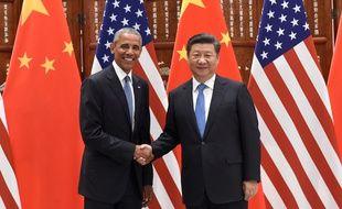 Le président chinois Xi Jinping et le président américain Barack Obama avant le G20 de Hangzhou, en Chine. Les deux pays viennent de ratifier ce samedi l'accord mondial sur le climat issue de la COP21 de Paris.