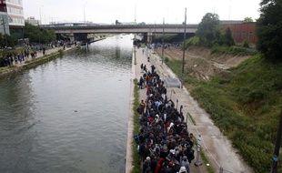 Paris, le 30 mai 2018. - Evacuation des migrants du campement du Millénaire à Paris (XIXe).