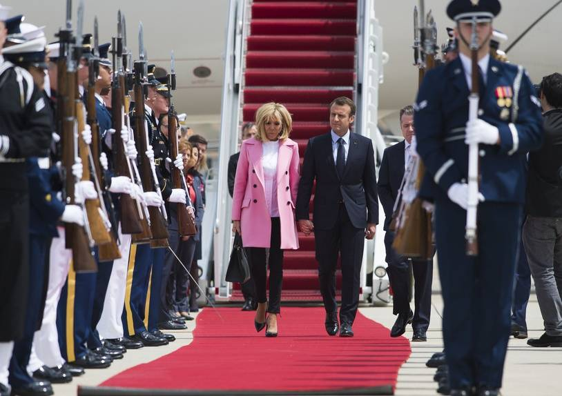 French President Emmanuel Macron and his wife Brigitte Macron arrive at Joint Base Andrews in Maryland on April 23, 2018. President Macron is in the US on a three-day state visit.