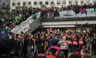 """Extinction Rebellion climate activists protest at the shopping center """"Italie 2"""", in Paris, France, Saturday, Oct. 5, 2019."""