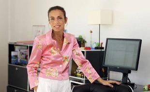 La PDG de l'Institut national de l'audiovisuel (INA), Agnès Saal, dans son bureau au siège de l'INA, à Bry-sur-Marne, le 31 juillet 2014