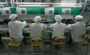 Ouvriers de l'usine FoxConn à Longhua, dans la province chinoise du Guangdong, le 26 mai 2010.