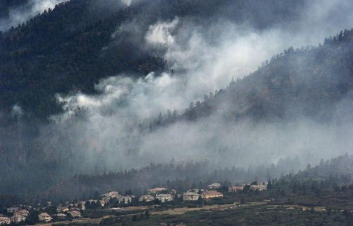 """Le président Barack Obama a déclaré vendredi """"l'état de grande catastrophe"""" dans l'Etat du Colorado (ouest) où des incendies ont détruit des centaines de maisons et forcé environ 36.000 personnes à évacuer les lieux. – Robyn Beck afp.com"""