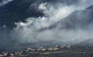 """Le président Barack Obama a déclaré vendredi """"l'état de grande catastrophe"""" dans l'Etat du Colorado (ouest) où des incendies ont détruit des centaines de maisons et forcé environ 36.000 personnes à évacuer les lieux."""