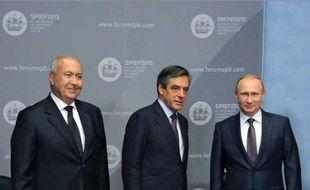 Makhzoumi, Fillon et Poutine le 19 juin 2015 à Saint-Pétersbourg.