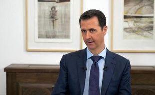 Photo publiée le 27 mars 2015 par l'agence de presse syrienne (Sana) et montrant le président Bachar al-Assad lors d'un entretien à huit médias russes