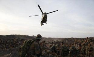 En première ligne au Mali et en Centrafrique, velléitaire en Syrie, pugnace dans le dossier iranien: la France a acquis en 2013 le statut, réservé de coutume aux Etats-Unis, de pays occidental le plus interventionniste.