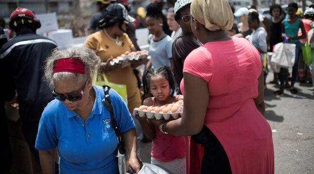 Des habitants de Saint-Martin à une distribution de vivres, le 12 septembre 2017. – Martin BUREAU / AFP