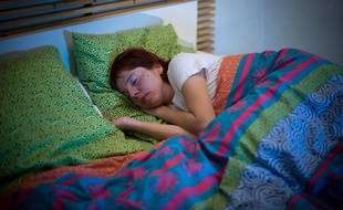 Une femme en plein sommeil. Illustration.