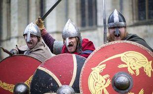 Trois Vikings, visiblement pas très ravis de l'annonce de cette fin du monde.