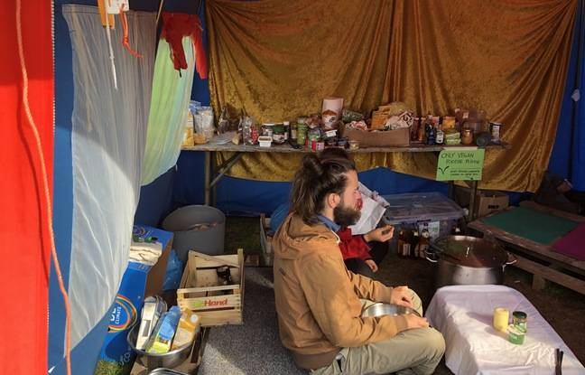 An activist on hunger strike for climate in Berlin eats a small portion of porridge to regain some strength and deliver a speech on Thursday 23 September 2021 outside the Reichstag, as activists are still waiting for chancellor candidates to meet them.