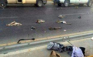 Photo prise à partir d'un téléphone portable et montrant des uniformes de l'armée irakienne éparpillés après un assaut des jihadistes à Mossoul, le 10 juin 2014