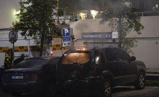 Plusieurs véhicules ont de nouveau été la proie des flammes au cours de la sixième nuit consécutive d'incidents dans les quartiers pauvres de la banlieue de Stockholm, où la tension semble cependant avoir diminué d'intensité.