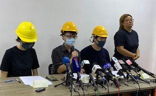 Des manifestants se sont présentés masqués devant la presse, à Hong Kong, le 6 août 2019.