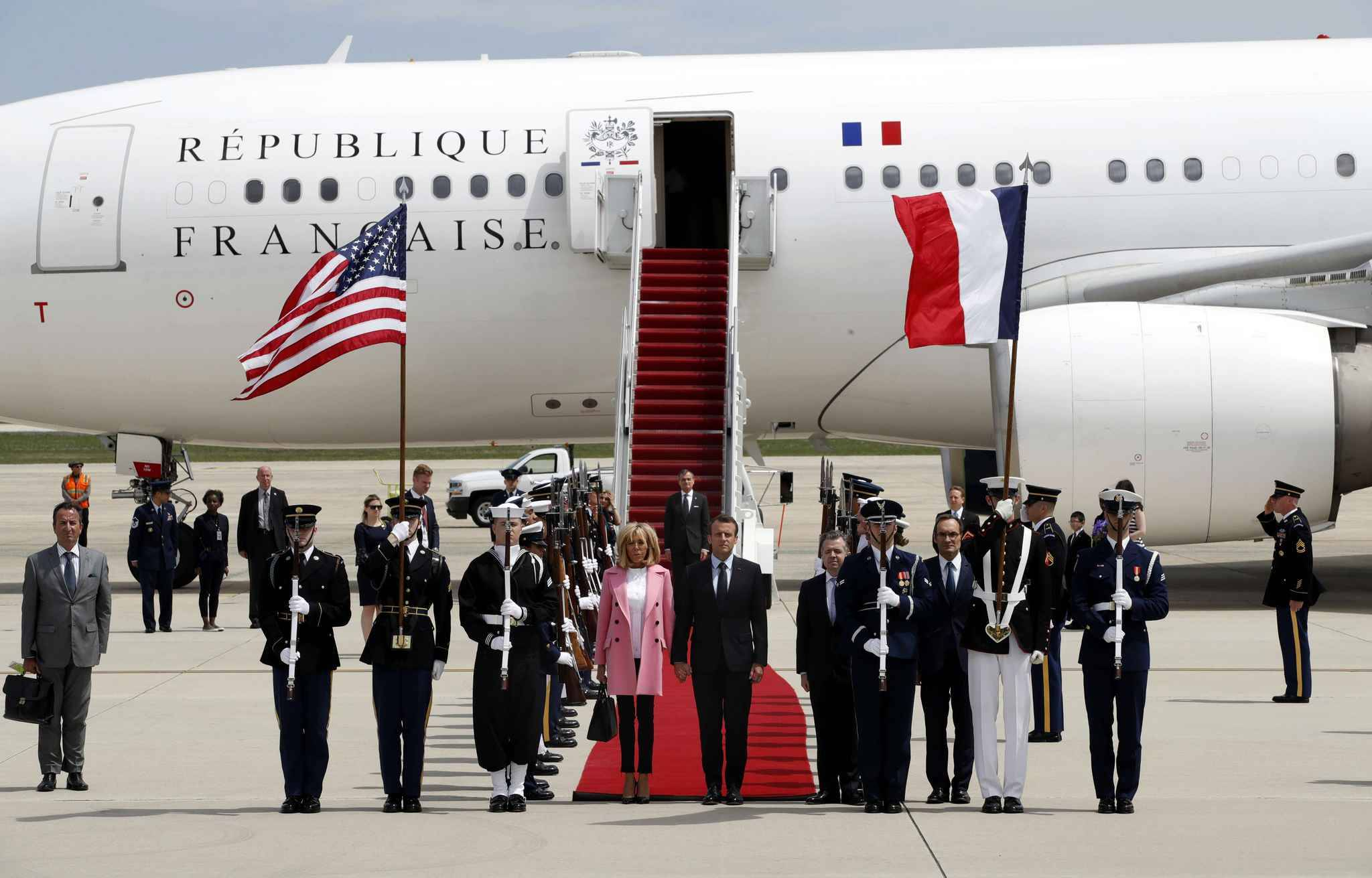 French President Emmanuel Macron and his wife Brigitte Macron arrive at Andrews Air Force Base, Md., Monday April 23, 2018. President Donald Trump, celebrating nearly 250 years of U.S.-French relations, will be hosting Macron at a glitzy White House state visit.