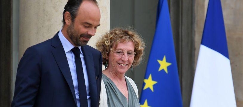 Le Premier ministre Edouard Philippe et sa ministre du Travail Muriel Pénicaud devant l'Elysée le 30 août 2017.