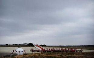 Aucun bruit dans le hall, pas un client aux comptoirs d'embarquement: à Huesca, dans les Pyrénées espagnoles, un aéroport fantôme attend les hypothétiques voyageurs, symbole d'un pays en crise après avoir construit à tout-va pendant la bulle immobilière.
