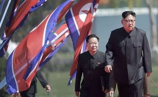 North Korean leader Kim Jong Un, right, arrives for the official opening of the Ryomyong residential area, a collection of more than a dozen apartment buildings, Thursday, April 13, 2017, in Pyongyang, North Korea.