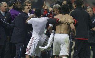 Gennaro Gattuso (torse nu), à la fin du match contre Tottenham, à Milan , le 15 février 2011.