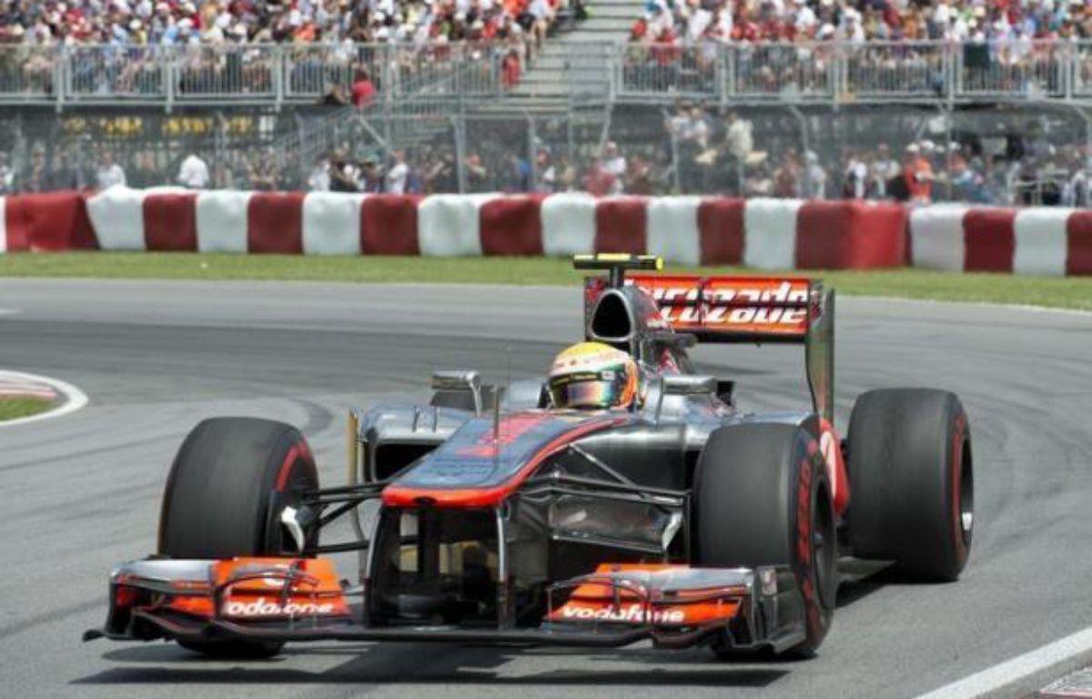 Le Britannique Lewis Hamilton (McLaren) a remporté le Grand Prix du Canada de Formule 1, 7e manche de la saison 2012, dimanche sur le circuit Gilles-Villeneuve, à Montréal, devant le Français Romain Grosjean (Lotus), 2e, et le Mexicain Sergio Pérez (Sauber), 3e. – Don Emmert afp.com