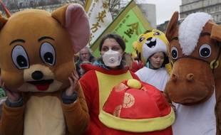 A Londres aussi, on porte des masques (ici, lors d'un défilé du Nouvel an chinois)