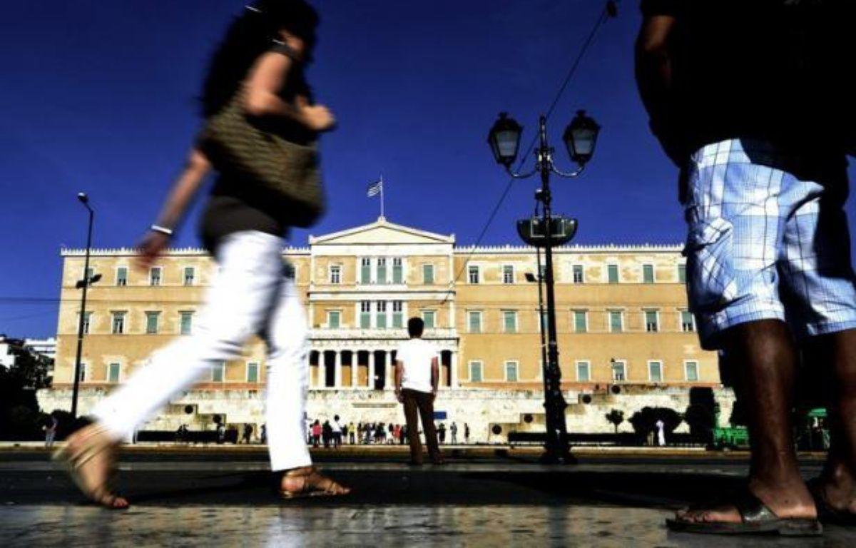 La Grèce toujours en quête d'un gouvernement après le rejet électoral de l'austérité, s'interrogeait mercredi sur les intentions de l'Union européenne de lui verser ou non comme prévu cette semaine, une tranche de prêts visant à la sauver du défaut de paiement. – Louisa Gouliamaki afp.com