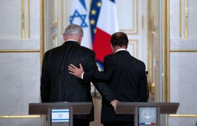 """Le président François Hollande a assuré jeudi à une communauté juive inquiète qu'il veillerait à sa sécurité et a admis des """"failles"""" dans l'enquête Merah, lors d'un hommage émouvant aux victimes du tueur au scooter, en compagnie du Premier ministre israélien Benjamin Netanyahu."""