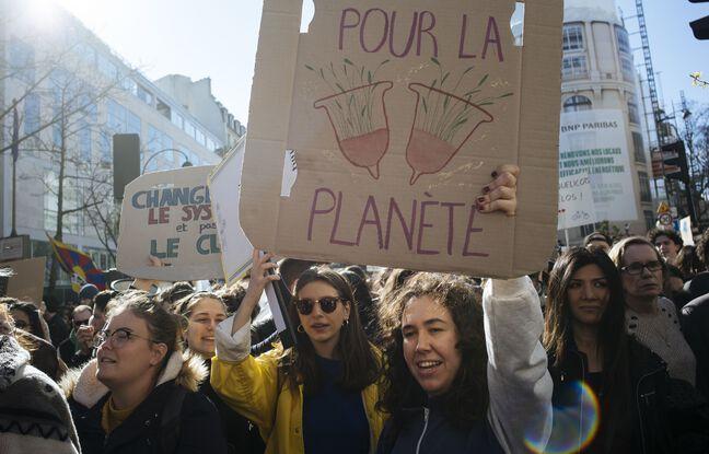 648x415 militantes lors marche climat paris 16 mars 2019