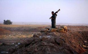 Un combattant peshmerga sur la ligne de front d'Erbil (Irak), le 5 octobre 2014